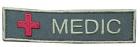 """""""Medic"""" merke brodert grønt"""